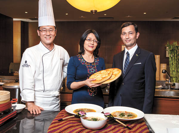 Chef Lee Jung-woo, left, poses with Mammetalyyeva and Mammetalyyev.