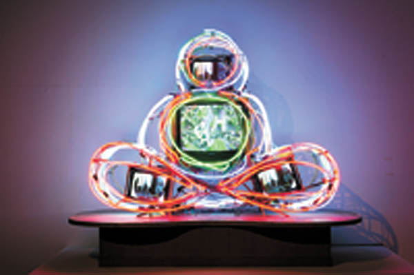 """Nam June Paik's """"Neon Buddha."""" Many museums will mark the 10th anniversary of the artist's death with special exhibitions this year. [SAMSUNG MUSEUM OF ART]"""