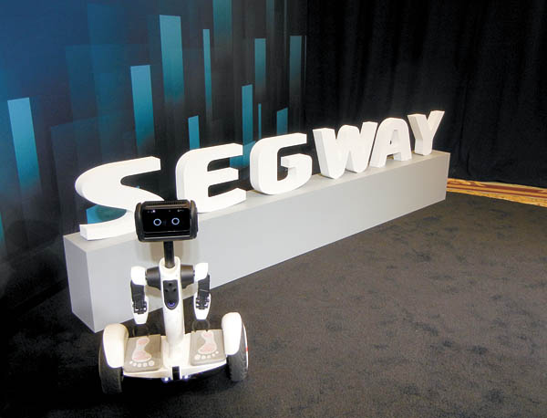 Segway displays a motorized scooter that can also function as a personal assistant. [XINHUA]