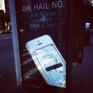 Uber advertisement at a bus stop shelter