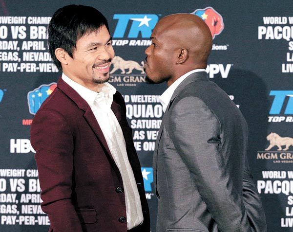 Manny Pacquiao and Timothy Bradley Jr. pose at a news conference in Beverly Hills, California, on Tuesday. They will fight on April 9 in Las Vegas. [AP/NEWSIS]