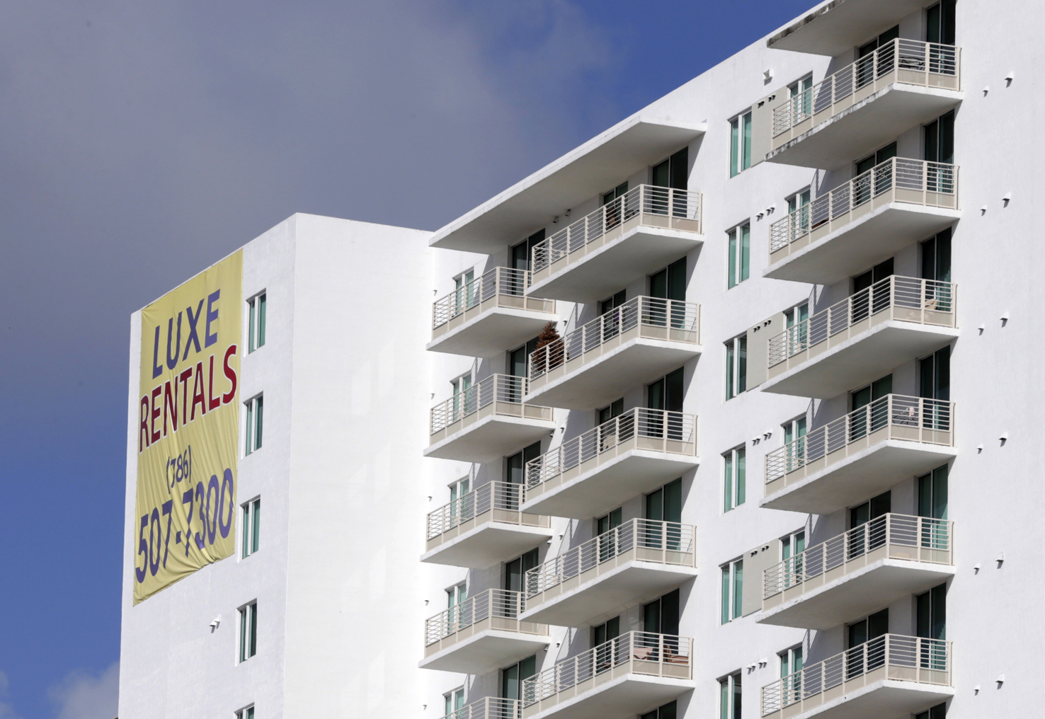 FILE - In this Tuesday, Feb. 2, 2016, photo, newly built apartments are advertised for rent in downtown Miami. On Friday, April 22, 2016, the real estate firm Zillow will release median home rental prices for March. (AP Photo/Lynne Sladky, File)