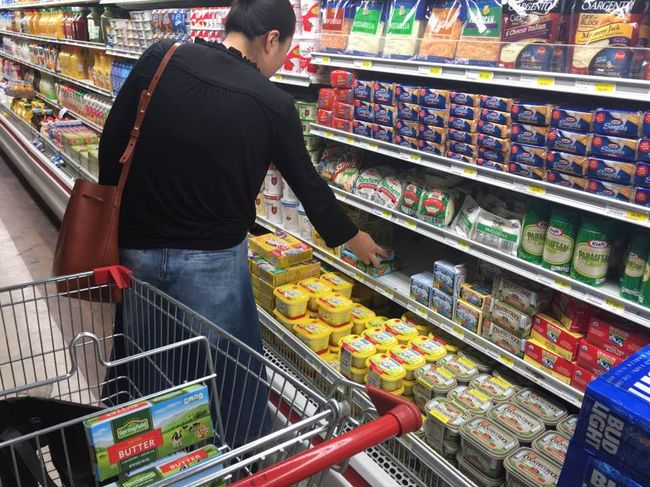 The high-fat diet, which has become popular in South Korea, is now one of the trending topics in Southern California. A woman is purchasing butter at a Koreatown market.
