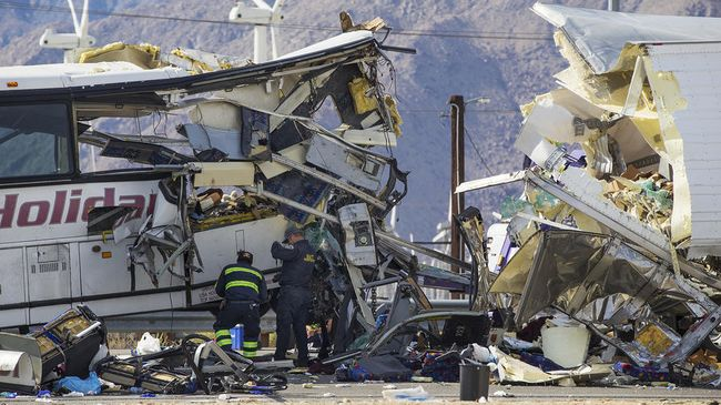 The bus was heavily destroyed after crashing into a trailer of a truck. [Photo provided by the Los Angeles Times]