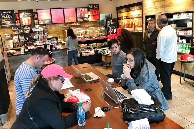 Coffee shops in Koreatown rake in the most number of customers before and after an average people's work hours. A customer is at Koreatown coffee shop on Wilshire Boulevard on Dec. 12 at 3 p.m. with a laptop.