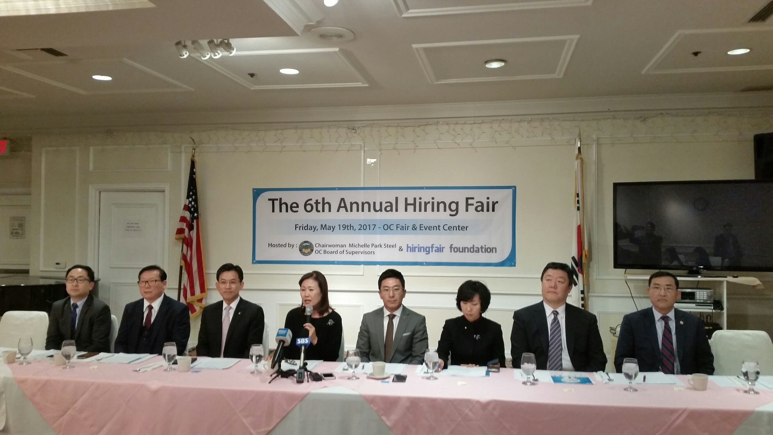 Nonprofit group Hiring Fair Foundation is announcing the plan to host a job fair in Orange County in May. Orange County Supervisor Commission's Michelle Steel (fourth from left) is giving an introductory speech at the press conference.